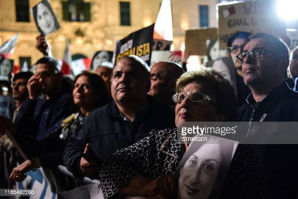 People holding placards and photos of killed journalist Daphne Caruana Galizia, stage a protest called by Galizia's family and civic movements, on...