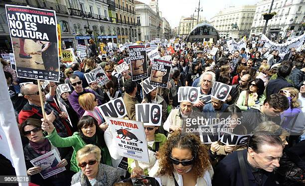 People holding placards reading Torture is not culture during a demonstration of thousands of people calling for the abolition of bullfights on March...