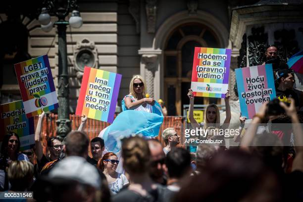 People holding rainbow-coloured placards during the Gay Pride parade on June 24, 2017 in Belgrade. The march was held without incidents amid tight...