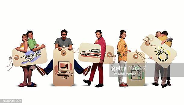 People holding tags with consumer themes illustrations (Composite)