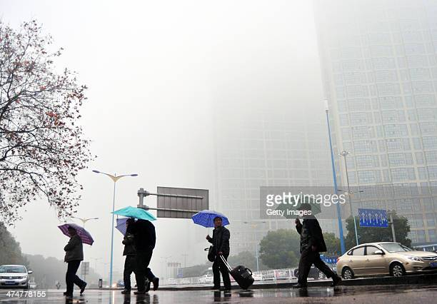 People holding umbrella walk in the haze on February 24 in Changsha Hunan Province of China Altogether 143 million sq km of China's land territory...