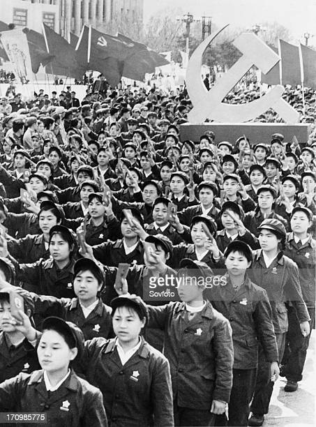 People holding up mao's little red book during a may day demonstration in beijing china may 1 cultural revolution