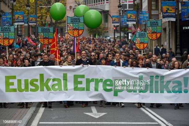 People holds a banner reading 'Basque republic' during a demonstration against the Spanish Constitution and in favor of a Basque Republic in Bilbao...
