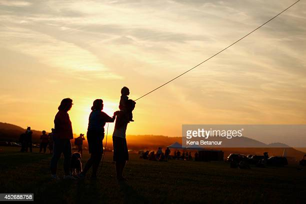 People holds a Hot air balloon during the 32nd annual QuickChek New Jersey Festival of Ballooning on July 25 2014 in Readington New Jersey The...