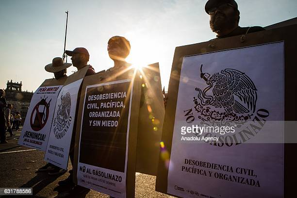 People holds banners against the gasoline hikes during a protest against the gasoline hike in Mexico City Mexico on January 15 2017