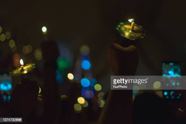 People holds candle during Christmas Eve mass at HKBP church in Pekanbaru Indonesia on December 24 2018