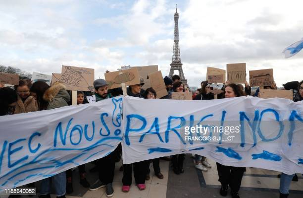 People holds cardboards depicting fishes during a demonstration of the Sardine Movement formed to oppose the farright League party in front of the...