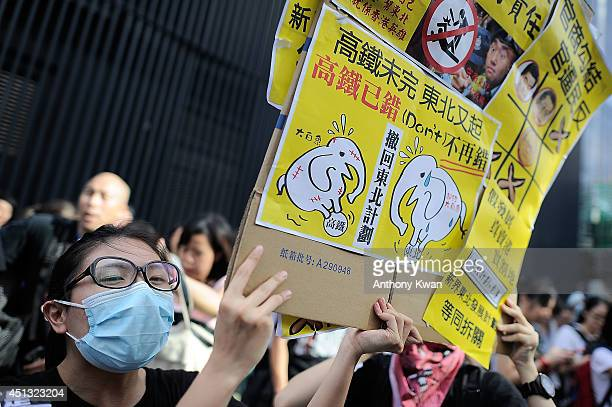 People holds placards and shout slogans during a rally outside of Legislative Council Building on June 27 2014 in Admiralty Hong Kong Protesters are...