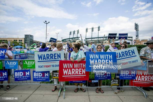 People holds signs in support of Senator Elizabeth Warren, a Democrat from Massachusetts and 2020 presidential candidate, outside of the Fox Theater...