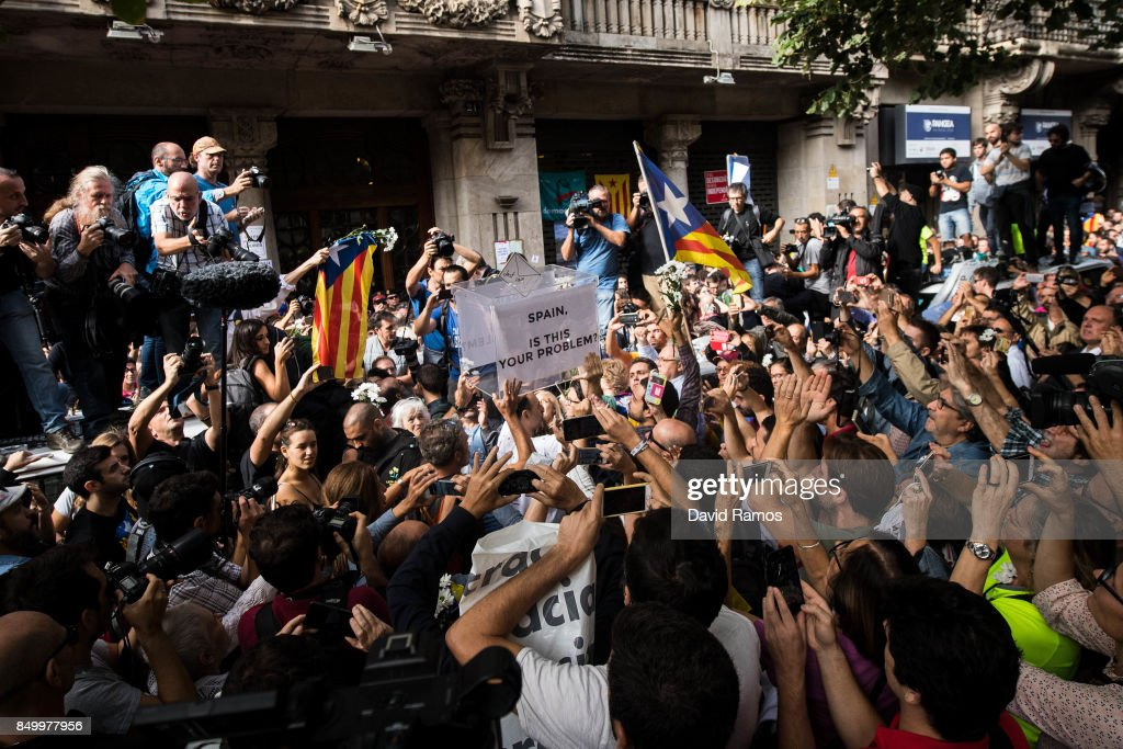 People holds up a ballot box where reads 'Spain, is this your problem?' outside the Catalan Vice-President and Economy office as police officers holds a searching operation inside on September 20, 2017 in Barcelona, Spain. Spanish Civil Guard police have stormed several Catalan government ministries in an attempt to stop the region's independence referendum on October 1, which has been deemed illegal by the Spanish government in Madrid.