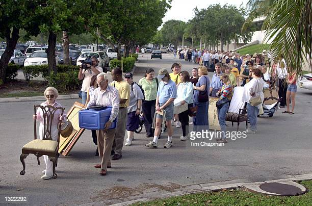 People hoping to appear on the Chubb''s Antiques Roadshow television show stand in line June 16 2001 outside the Coconut Grove Convention Center in...