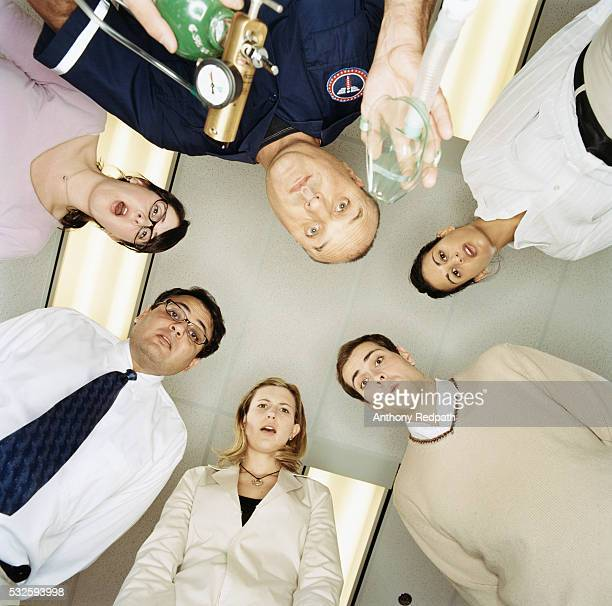people huddled over person who fainted - unconscious stock pictures, royalty-free photos & images