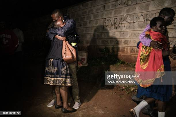 TOPSHOT People hug after their evacuation from the DusitD2 compound in Nairobi after a blast followed by a gun battle rocked the upmarket hotel...