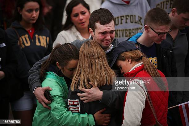 People hug and cry during a vigil for victims of the Boston Marathon bombings at Boston Commons on April 16 2013 in Boston Massachusetts The twin...