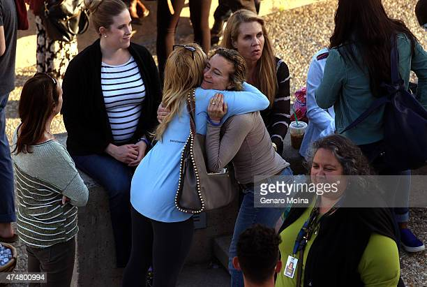 People hug and participate in a UC Santa Barbara studentled gathering on May 23 2015 in remembrance of those who were killed and injured by Elliot...