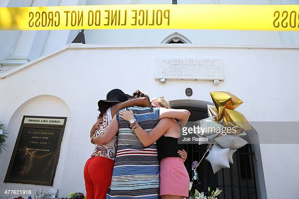 People hug as they pay their respects in front of Emanuel AME Church on June 18 2015 in Charleston South Carolina Nine people were killed on June 17...