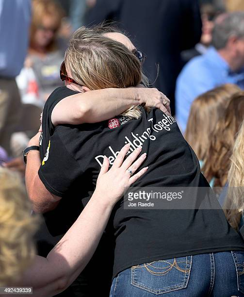 People hug during the remembrance ceremony for the victims of last year's tornado on May 20 2014 in Moore Oklahoma On May 20 2013 a twomile wide EF5...