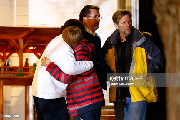 People hug outside of the Newtown United Methodist Church on December 14 2012 in Newtown Connecticut Twentyseven are dead including 20 children after...
