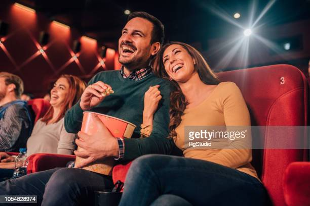 people hugging at cinema - comedy film stock photos and pictures