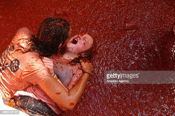 People hurl tomatoes while participating the annual La Tomatina festival in Bunol district of Valencia Spain on August 26 2015