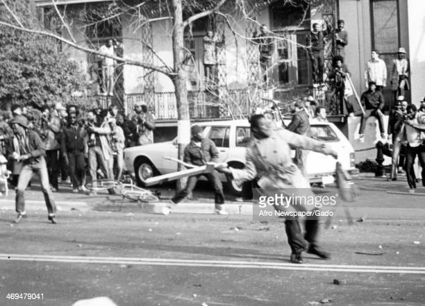 People hurling boards and bricks during the Anti Klan anti racist protest in Washington DC Washington DC November 27 1982