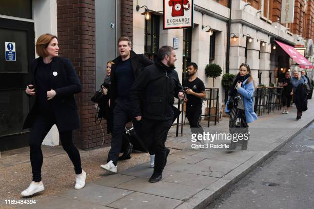 People hurriedly leave the area after reports of shots being fired on London Bridge on November 29 2019 in London England Police responded to an...