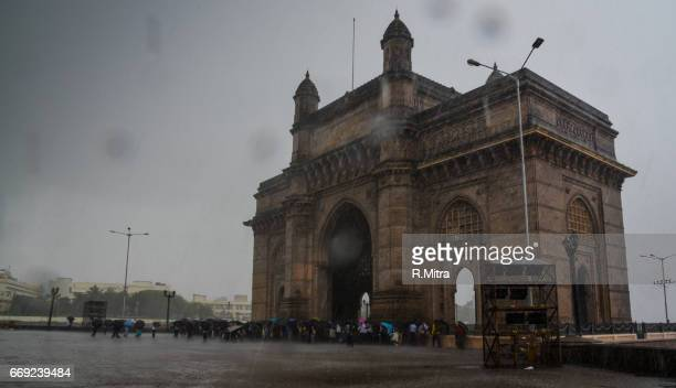 People hurrying for shelter in the rains, Gateway of India!