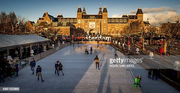 People ice skate and play ice hockey on November 21 2015 in a ice skating spot in front of the od the Rijksmuseum in Amsterdam OUT==