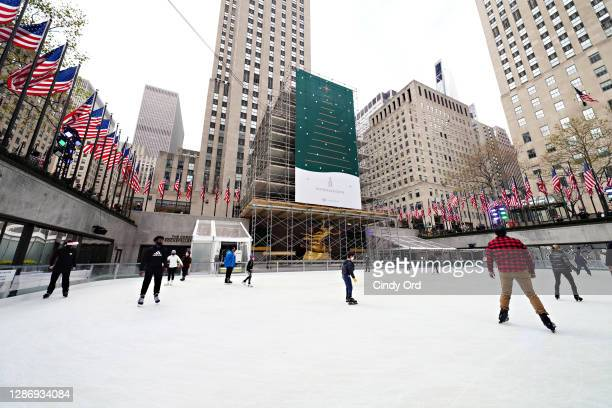 People ice skate as The Rink at Rockefeller Center opens for the season with limited capacity and additional safety precautions imposed to slow the...