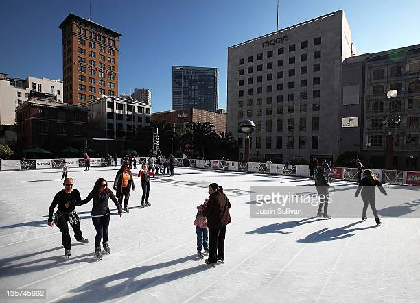 People ice skate at a small rink at Union Square on December 13, 2011 in San Francisco, California. With less than two weeks before Christmas, San...
