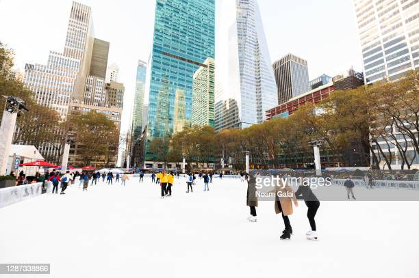 People ice skate at the Bank of America Winter Village at Bryant Park on November 23, 2020 in New York City. The pandemic has caused long-term...