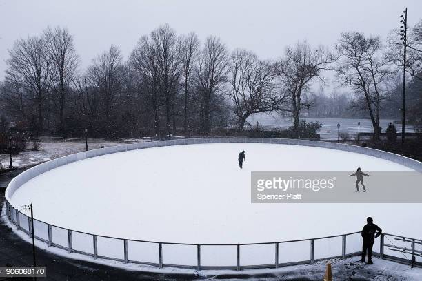 People ice skate on a rink in Prospect Park on snowy afternoon on January 17 2018 in New York City New York City is expected to receive up to two...