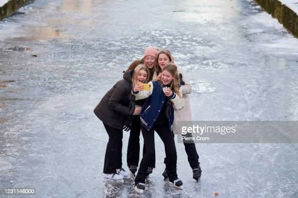 People ice skate on the frozen canals on February 13, 2021 in Delft, Netherlands. Parts of central and northern Europe and Britain have experienced...
