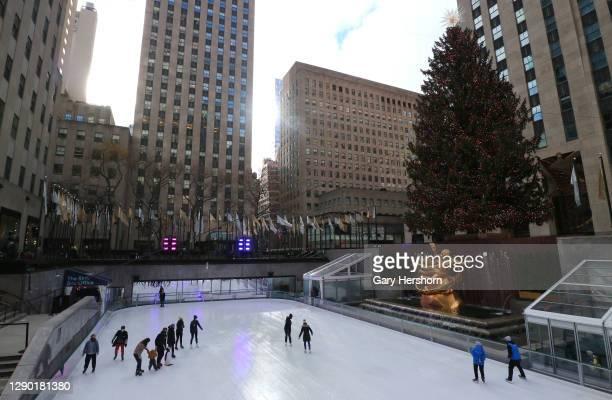 People ice skate under the Rockefeller Center Christmas tree on December 8, 2020 in New York City.