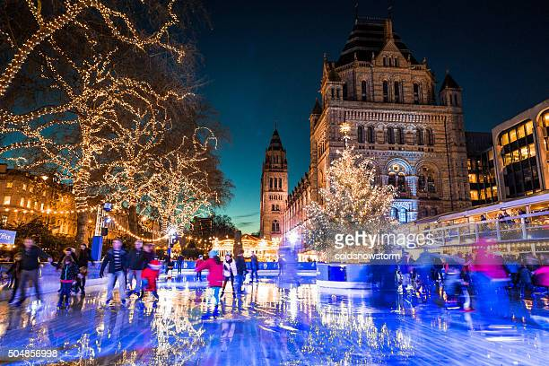 People Ice Skating, Natural History Museum in Kensington, London, UK