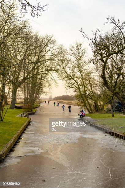 "people ice skating on frozen canals in the weerribben wieden nature reserve in holland - ""sjoerd van der wal"" or ""sjo"" stock pictures, royalty-free photos & images"
