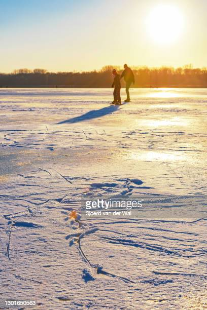 People ice skating on the Drontermeer lake near Kampen and Dronten during a cold winter day in The Netherlands on February 11, 2021 in Kampen,...