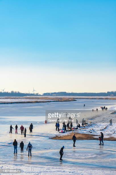 People ice skating on the Reeve waterway in the Reevediep bypass lake near Kampen during a cold winter day in The Netherlands on February 11, 2021 in...