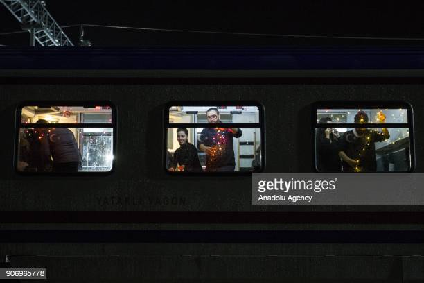 People illuminate the compartment of the Eastern Express which travels from Ankara to Kars with lights ahead of departure in Ankara Turkey on January...