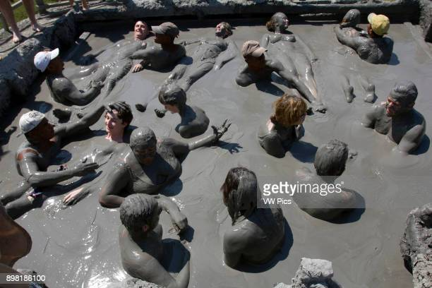 People immersed in the El Totumo Mud Volcano The mud volcano located in northern Colombia in the municipality of Santa Catalina is a local tourist...