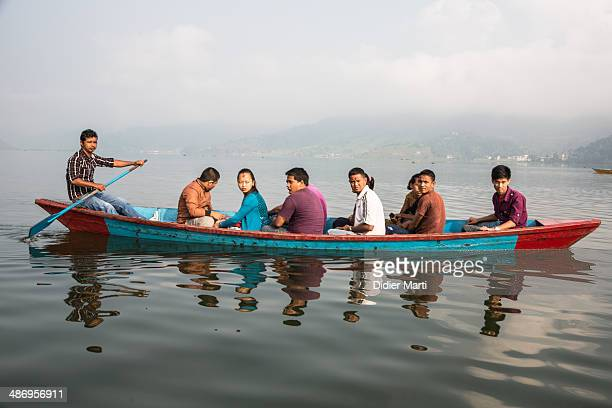 People in a boat on Phewa lake in Pokhara in Nepal