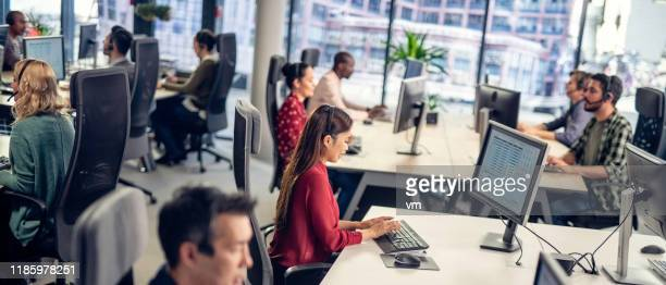 people in a call centre conducting market research - voting stock pictures, royalty-free photos & images