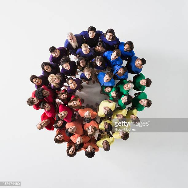 People in a Circle Looking Up and Smiling