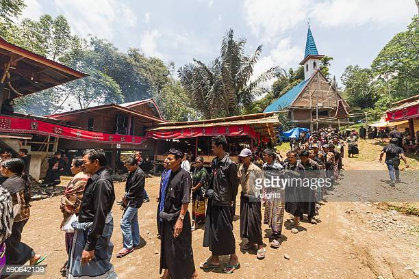 People in a formal funeral procession called Ma'passa Tedong at a rante the ceremonial site for a Torajan funeral in Sereale Toraja Land South...