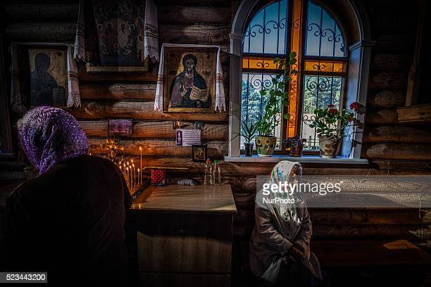 People in a holy mass in the church of Slavutich Ukraine city of the relocated workers after the accident of the Chernobyl nuclear plant Ukraine on...