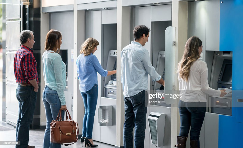People in a line at an ATM : Stock Photo
