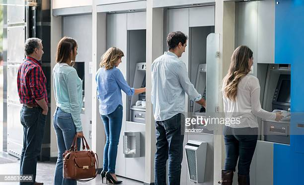 people in a line at an atm - in a row stock pictures, royalty-free photos & images