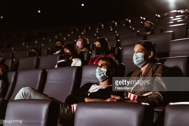 people in a movie theater during covid-19 coronavirus pandemic - film festival stock pictures, royalty-free photos & images