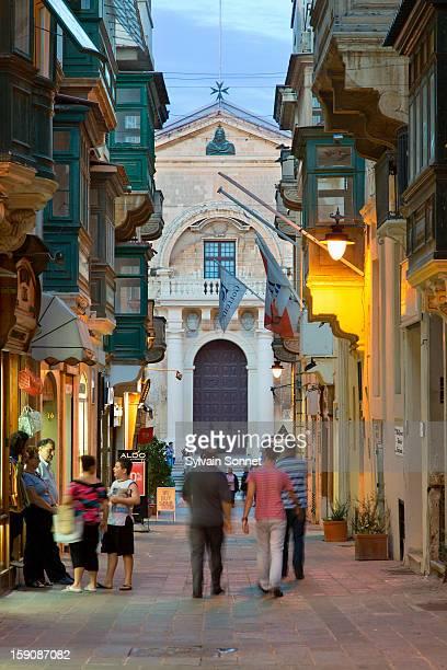 People in a pedestrian street, Valetta, Malta