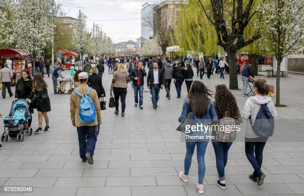 People in a pedestrian zone Street scene in Pristina on March 30 2017 in Pristina Kosovo